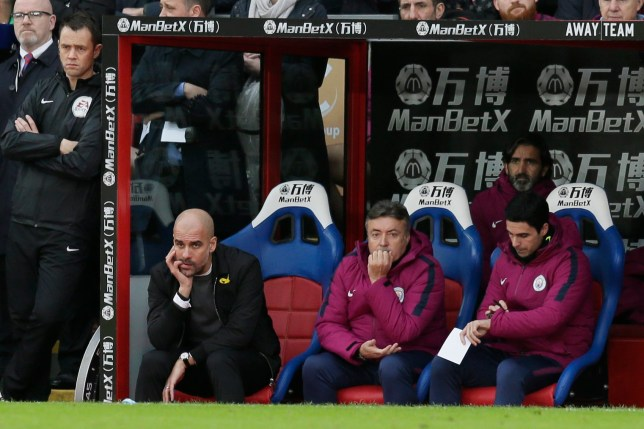 Pep Guardiola looks dejected on the subs bench