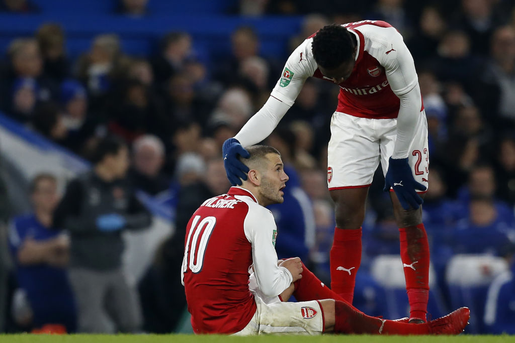 Jack Wilshere limps out of Arsenal's clash against Chelsea with ankle injury