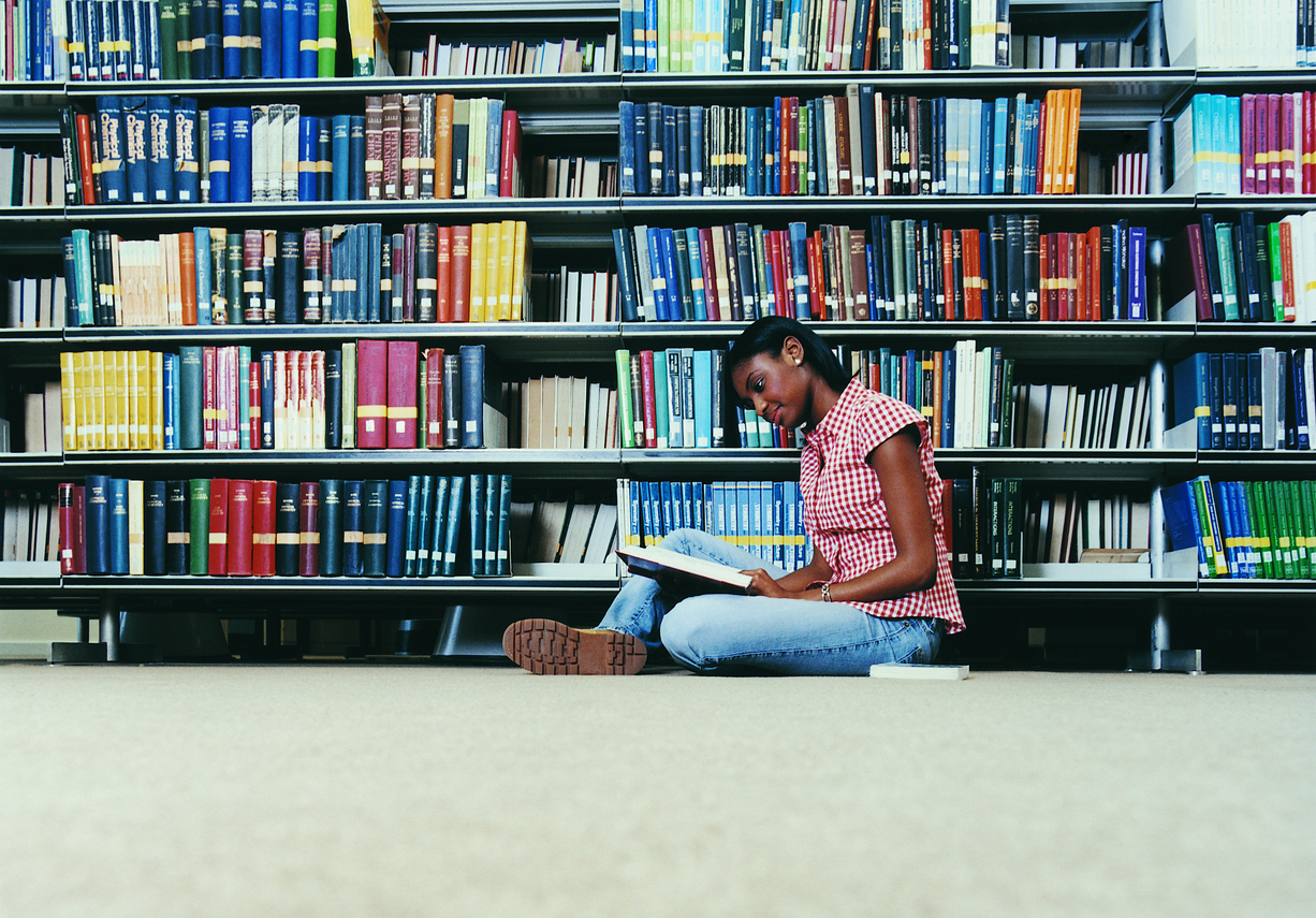 Picture of a woman studying in a library
