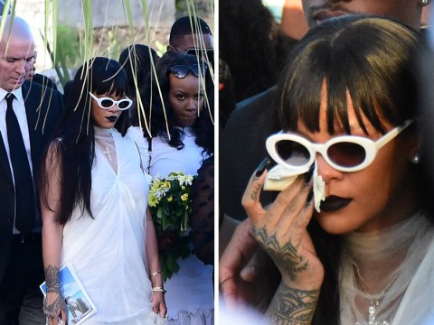Rihanna wipes away tears at murdered cousin's funeral in Barbados as she lays wreath on his grave
