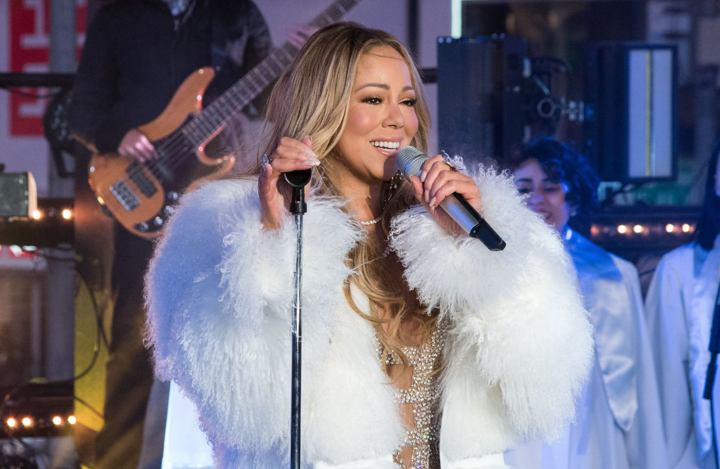 Mariah Carey bounces back with New Year performance after last year's disaster, but is miffed there's no hot tea