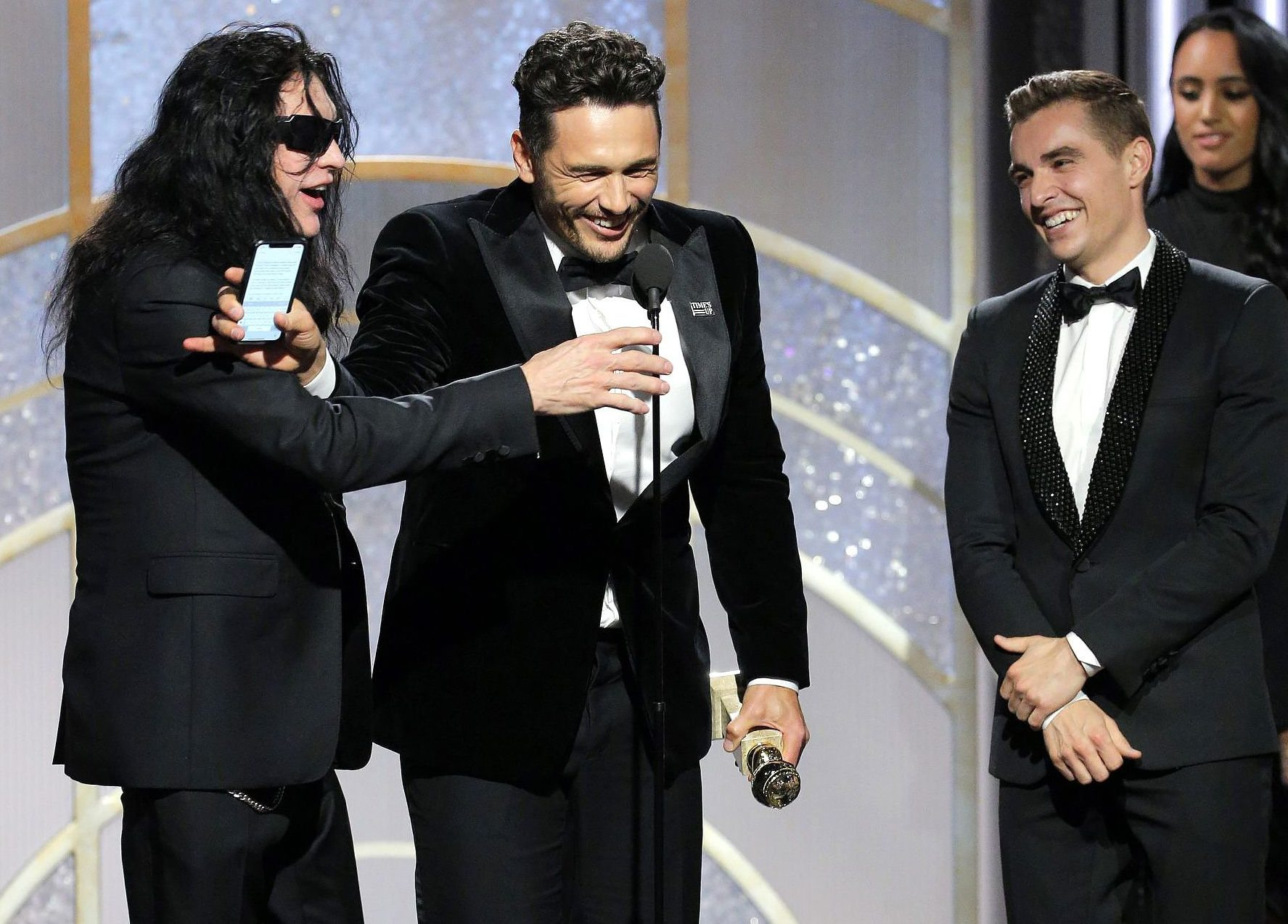 James Franco pushes The Room's Tommy Wiseau away from the mic at the Golden Globes