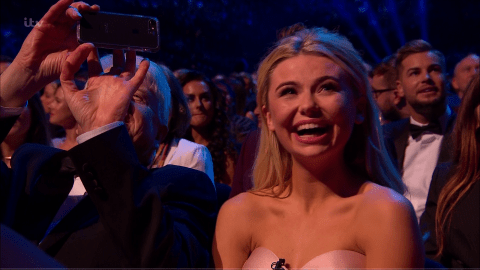 Aww! Stanley Johnson is like a proud father as he takes photo of the TV screen during I'm A Celeb nomination