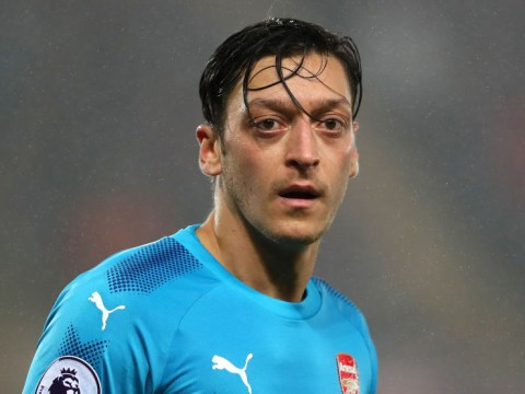 Mesut Ozil must help Arsenal win trophies and return to the Champions League after signing new deal, says Gary Neville