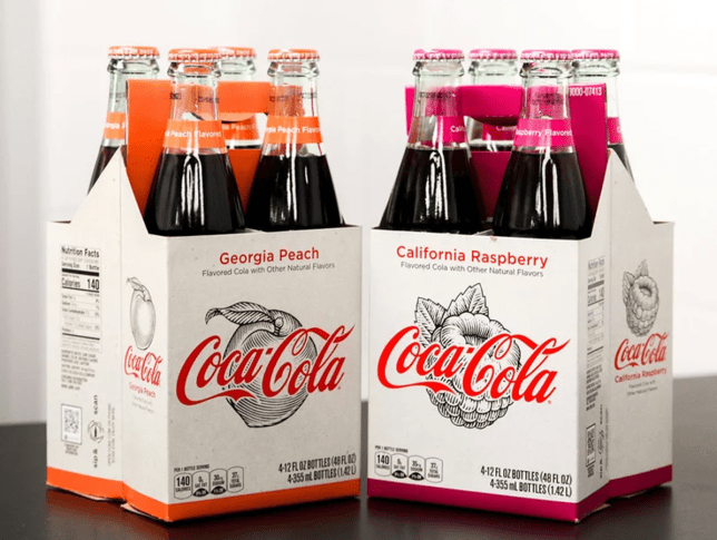 """Coca-Cola Introduces Georgia Peach and California Raspberry Flavors The new flavors are intended to appeal to craft soda drinkers. MIKE POMRANZ February 22, 2018 Call it the craftication of every product under the sun. Even Coca-Cola isn't above trying to show a sense of local, handcrafted prowess—regardless of how counterintuitive that idea may be for one of the best-known brands on the planet. To wit, the soda giant is introducing two new flavors—its first since adding Vanilla Coke back in 2002—Georgia Peach and California Raspberry, which are meant to target the craft soda market. Coca-Cola says the two state-name-dropping new fruit flavors are """"locally-inspired"""" and are intended to harken back to the brand's """"hand-crafted heritage,"""" with Coke pointing out that, until 1932, the soda was mixed by hand at local soda fountains. """"Soda shops would experiment with different flavors,"""" Coca-Cola Archivist Ted Ryan said according to Beverage Daily. """"Vanilla and cherry were favorites, of course, but you'd also find locally-sourced flavors on top in different parts of the country. Peach was popular in the South and, believe it or not, maple syrup was common up north."""" Along those lines, Coke says that these new official flavors were created by sourcing actual Georgia peaches and California raspberries."""
