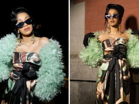 Cardi B hides midsection at New York Fashion Week amid claims she is 'three to four months pregnant'