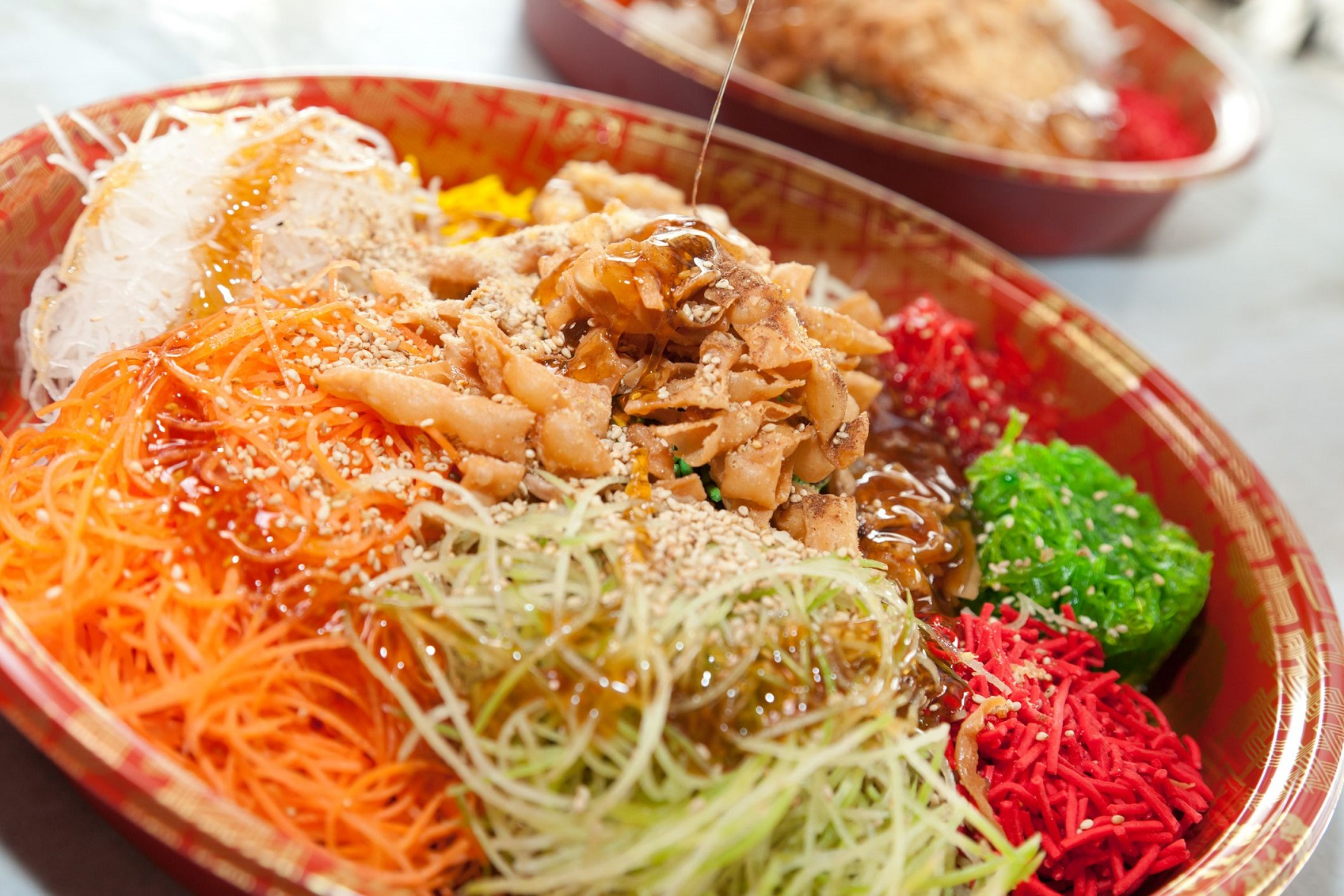 What is Lo Hei, the Chinese New Year dish, and where can I get it in London?