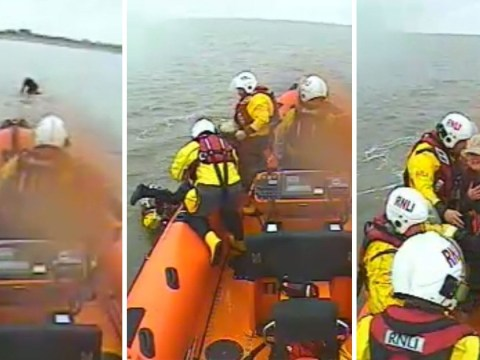 Dramatic rescue of woman trapped on top of submerged car