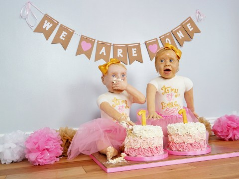 An amateur baker has created life-size versions of her twins out of cake