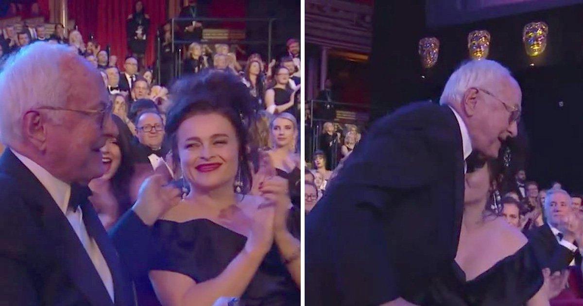 The awkward moment Helena Bonham Carter kisses James Ivory's shoulder at the Baftas