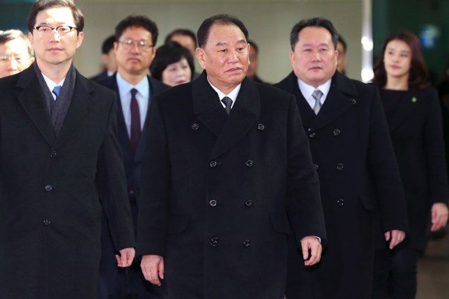 TOPSHOT - Kim Yong Chol (C), who leads a North Korean high-level delegation to attend the Pyeongchang 2018 Winter Olympic Games closing ceremony, arrives at the inter-Korea transit office in Paju on February 25, 2018. The blacklisted North Korean general arrived in the South on February 25 for the Winter Olympics closing ceremony, which will also be attended by US President Donald Trump's daughter Ivanka. / AFP PHOTO / KOREA POOL / KOREA POOL / South Korea OUTKOREA POOL/AFP/Getty Images