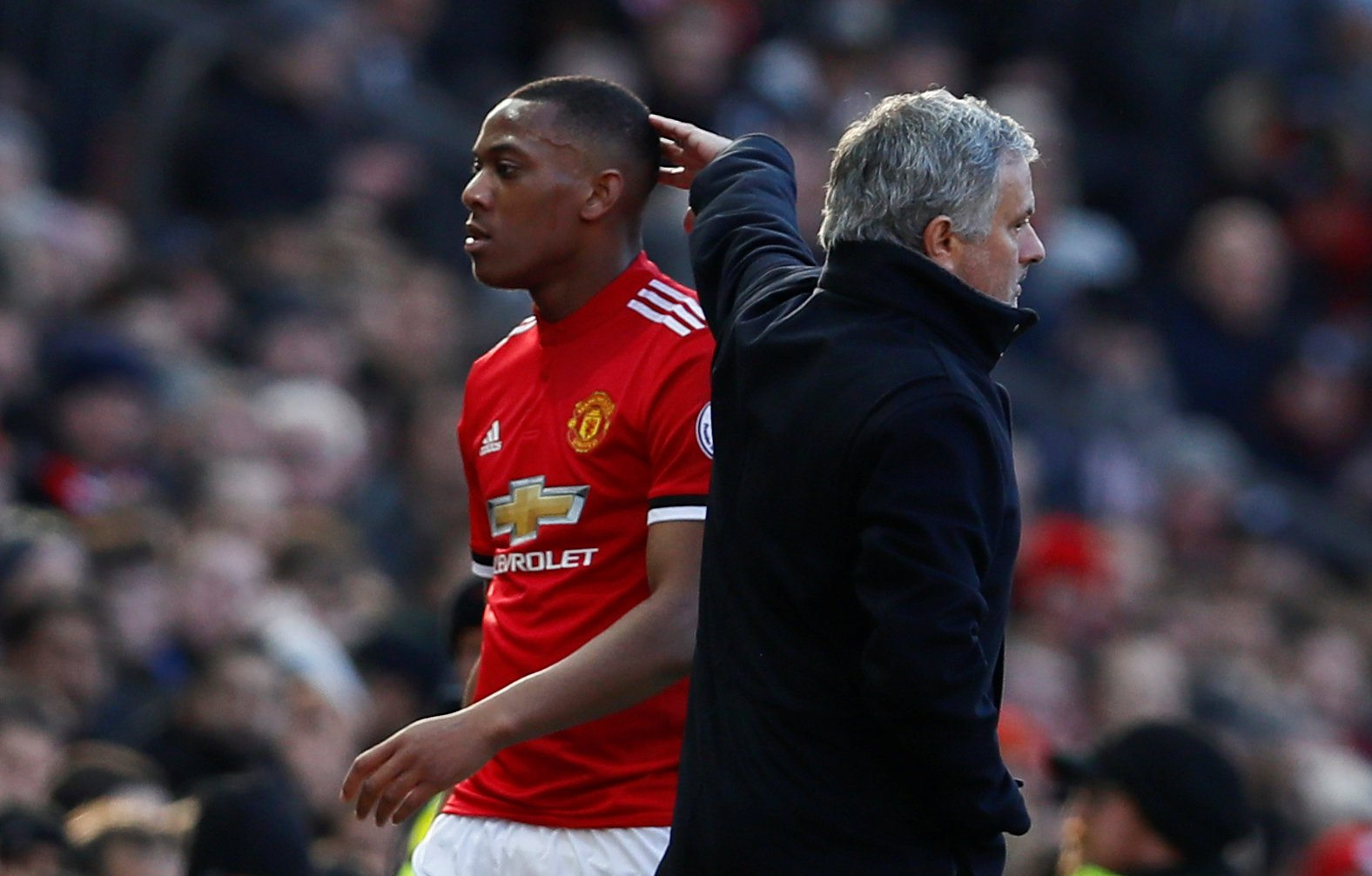 "Soccer Football - Premier League - Manchester United vs Chelsea - Old Trafford, Manchester, Britain - February 25, 2018 Manchester United's Anthony Martial walks past manager Jose Mourinho as he is substituted Action Images via Reuters/Jason Cairnduff EDITORIAL USE ONLY. No use with unauthorized audio, video, data, fixture lists, club/league logos or ""live"" services. Online in-match use limited to 75 images, no video emulation. No use in betting, games or single club/league/player publications. Please contact your account representative for further details."