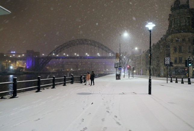 People walk through Newcastle Quayside following heavy overnight snowfall which has caused disruption across Britain. PRESS ASSOCIATION Photo. Picture date: Tuesday February 27, 2018. Roads across the UK have already seen a blanketing of snow, with police forces reporting treacherous driving conditions and blocked routes. See PA story WEATHER Snow. Photo credit should read: Owen Humphreys/PA Wire