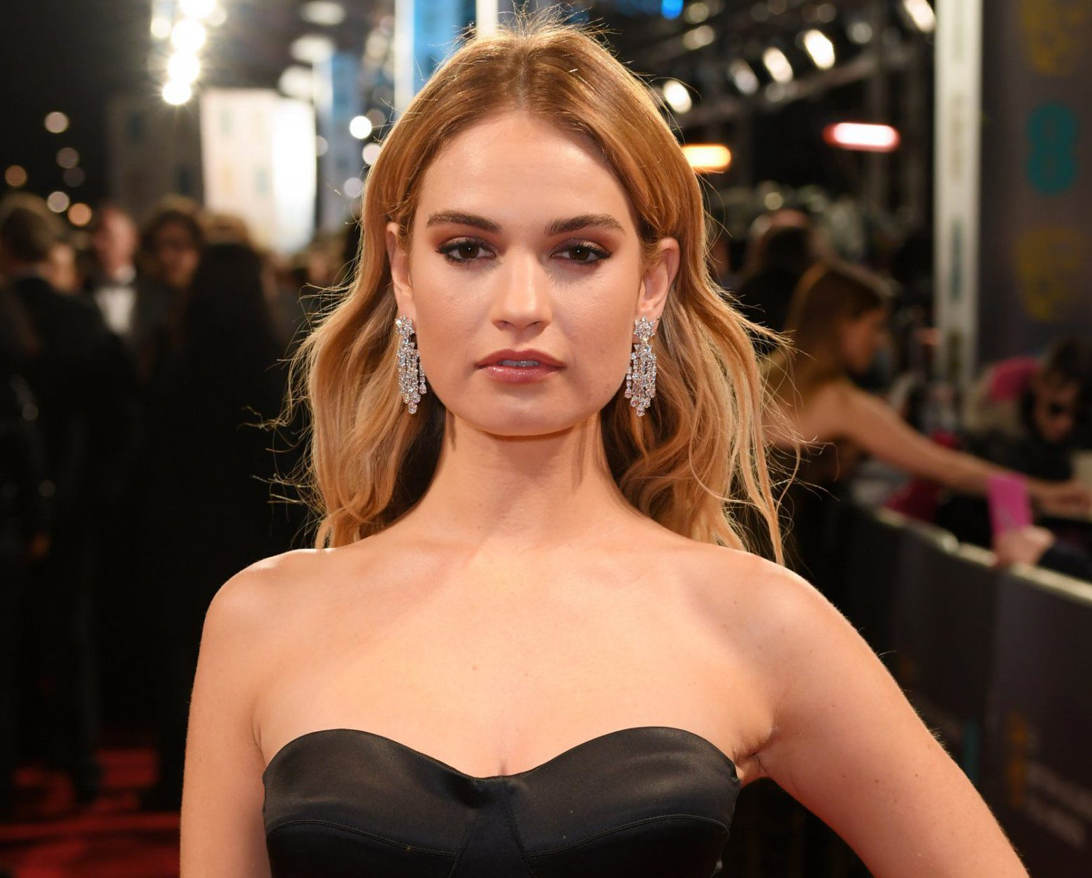 Lily James puts a stop to Matt Smith engagement rumours after wearing huge diamond on ring finger