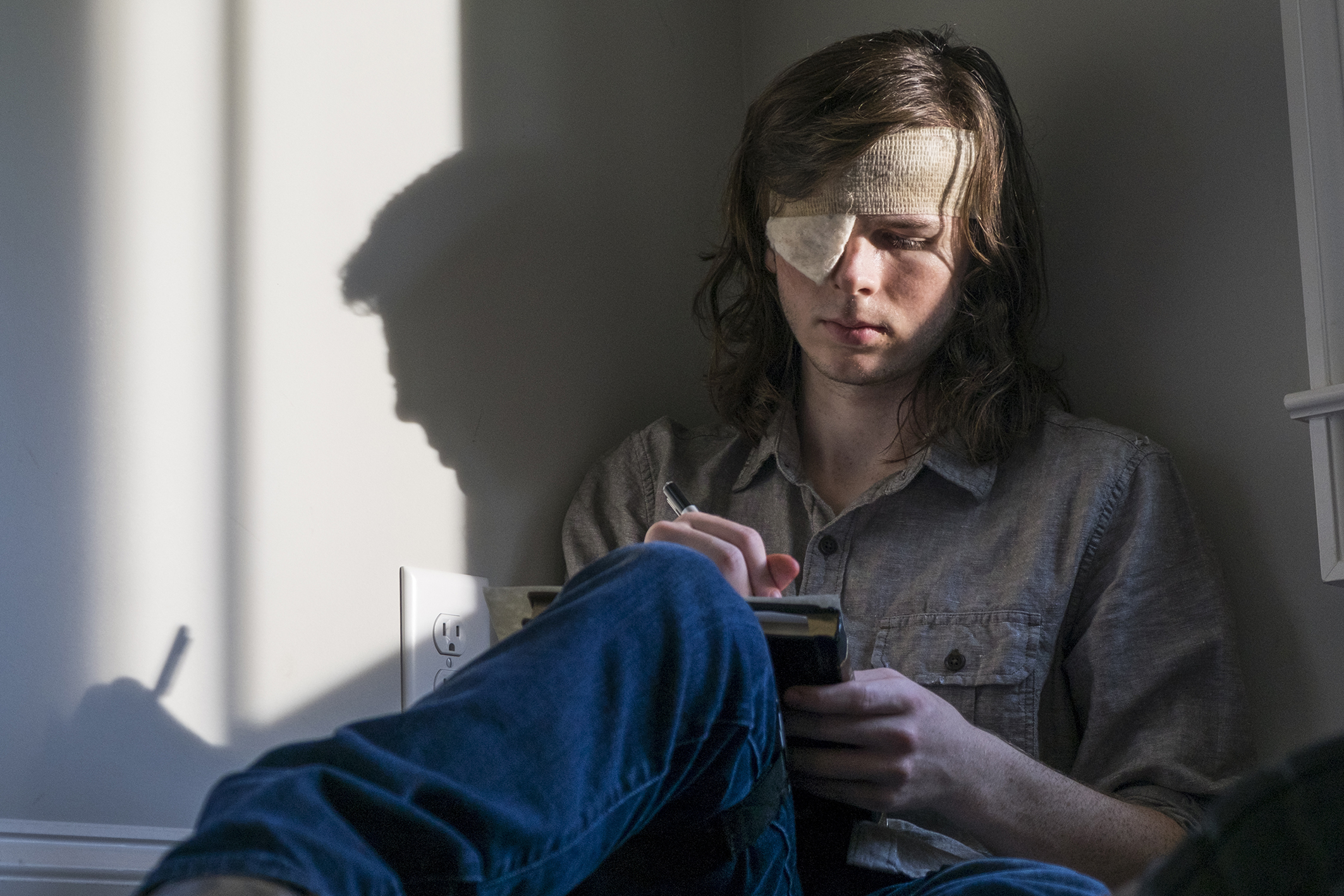 Chandler Riggs as Carl Grimes - who is leaving the show (Picture: Gene Page/AMC)