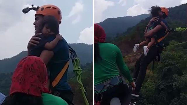 Dad does bungee jump while holding daughter in his arms