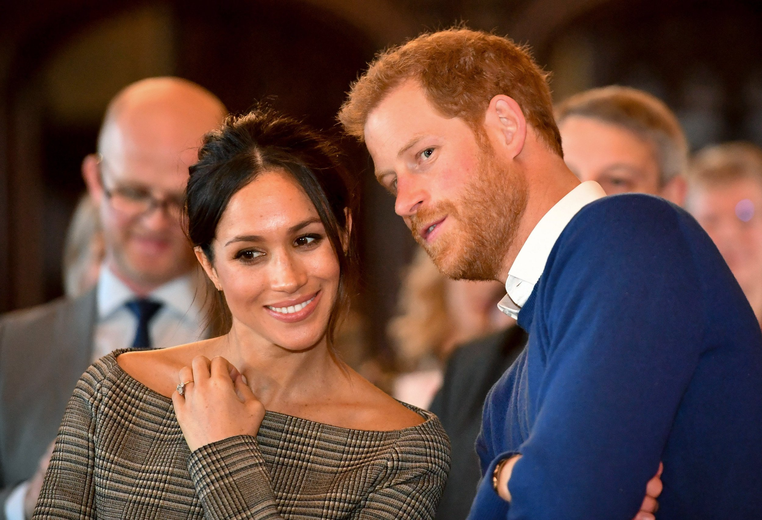 CARDIFF, WALES - JANUARY 18: Prince Harry whispers to Meghan Markle as they watch a dance performance by Jukebox Collective in the banqueting hall during a visit to Cardiff Castle on January 18, 2018 in Cardiff, Wales. (Photo by Ben Birchall - WPA Pool / Getty Images)