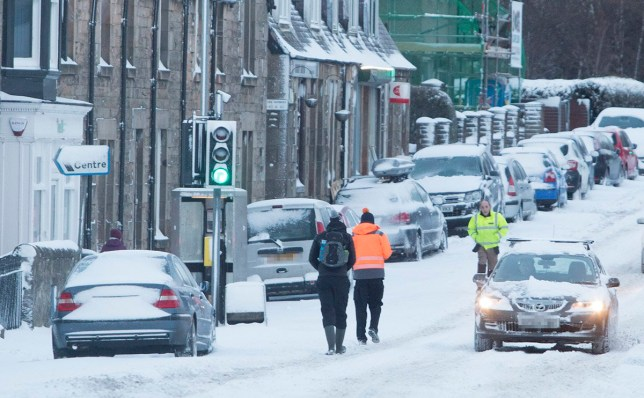 People in the village of Kirkliston which is usually busy with morning traffic walk down he road to avoid deep snow as the Red Weather Warning is still in place for central Scotland with the country hit by the Beast from the East. March 1 2018