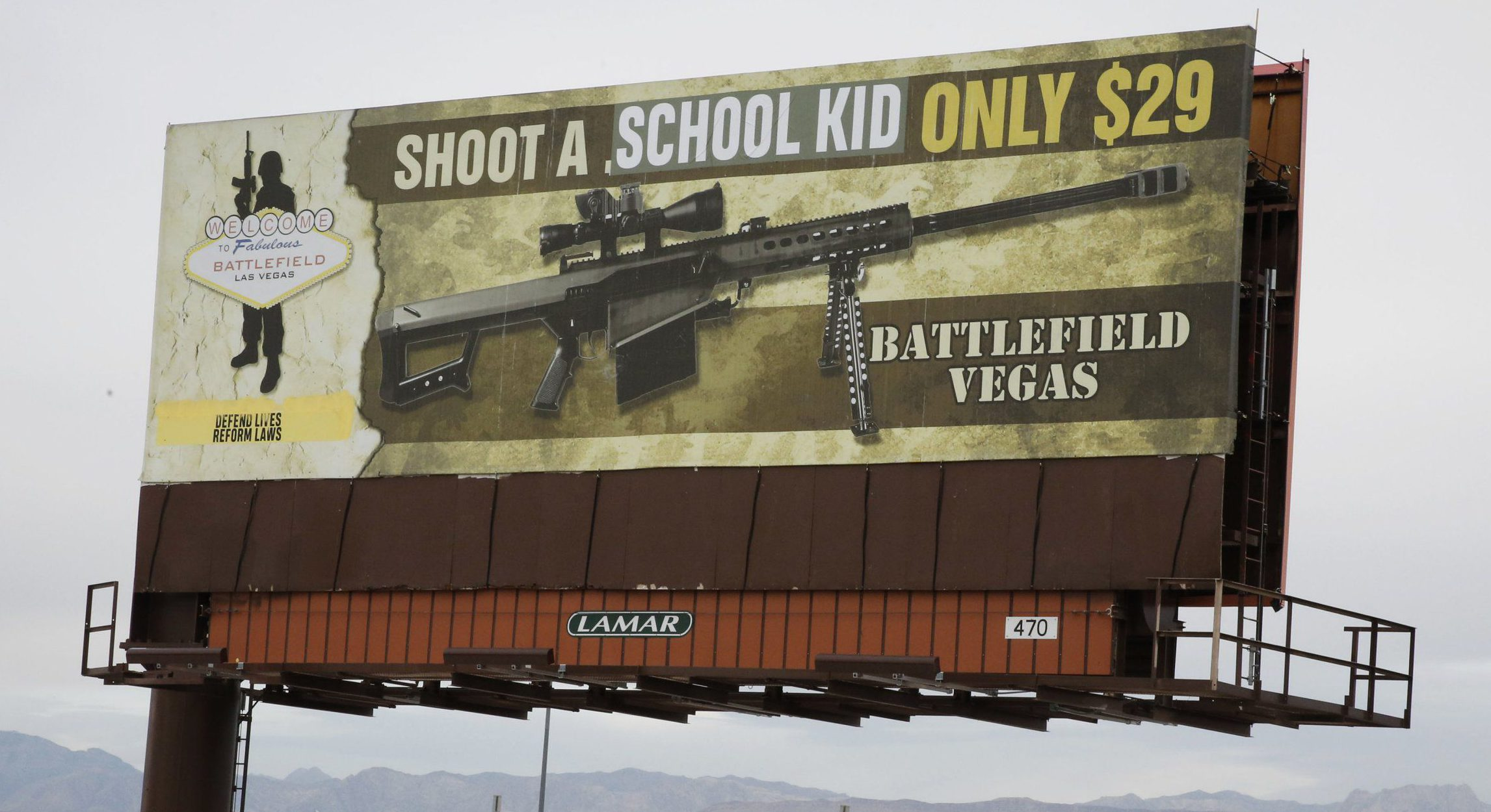 Vandalised billboard advertises shooting a school kid for $29