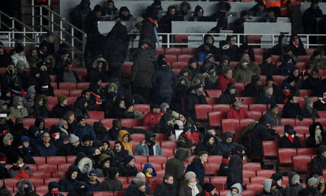 """Soccer Football - Premier League - Arsenal vs Manchester City - Emirates Stadium, London, Britain - March 1, 2018 General view of empty seats and fans leaving during the game Action Images via Reuters/Tony O'Brien EDITORIAL USE ONLY. No use with unauthorized audio, video, data, fixture lists, club/league logos or """"live"""" services. Online in-match use limited to 75 images, no video emulation. No use in betting, games or single club/league/player publications. Please contact your account representative for further details."""