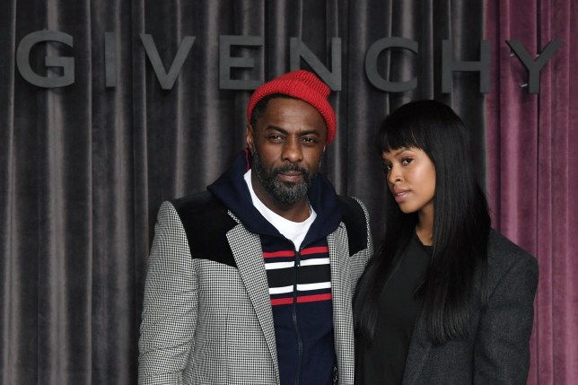 British actor and producer Idris Elba and Sabrina Dowhre pose during the photocall of Givenchy before the women's 2018/2019 fall/winter collection fashion show on March 4, 2018 in Paris. / AFP PHOTO / ALAIN JOCARDALAIN JOCARD/AFP/Getty Images