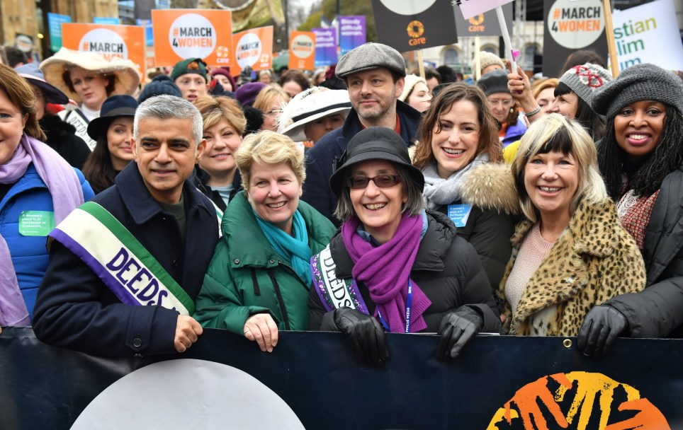 Marchers including Mayor of London Sadiq Khan, Sandi Toksvig, Michael Sheen and Helen Pankhurst (fourth right with purple scarf) gather outside the Palace of Westminster, central London, ahead of the March4Women. PRESS ASSOCIATION Photo. Picture date: Sunday March 4, 2018. The march will mark the centenary of the Representation of the Peoples Act 1918 by retracing the steps of the suffragettes past Parliament to Trafalgar Square. See PA story PROTEST March. Photo credit should read: Dominic Lipinski/PA Wire