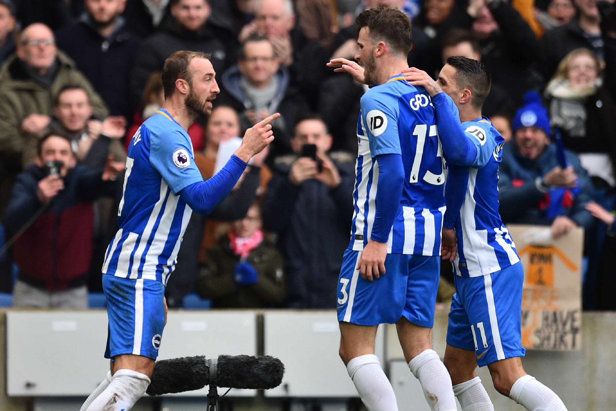 Brighton's English striker Glenn Murray (L) celebrates with teammates after scoring their second goal during the English Premier League football match between Brighton and Hove Albion and Arsenal at the American Express Community Stadium in Brighton, southern England on March 4, 2018. / AFP PHOTO / Glyn KIRK / RESTRICTED TO EDITORIAL USE. No use with unauthorized audio, video, data, fixture lists, club/league logos or 'live' services. Online in-match use limited to 75 images, no video emulation. No use in betting, games or single club/league/player publications. / GLYN KIRK/AFP/Getty Images