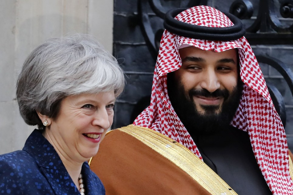 """Britain's Prime Minister Theresa May (L) greets Saudi Arabia's Crown Prince Mohammed bin Salman (R) outside 10 Downing Street, in central London on March 7, 2018. British Prime Minister Theresa May will """"raise deep concerns at the humanitarian situation"""" in war-torn Yemen with Saudi Crown Prince Mohammed bin Salman during his visit to Britain beginning Wednesday, according to her spokesman. / AFP PHOTO / Tolga AKMENTOLGA AKMEN/AFP/Getty Images"""