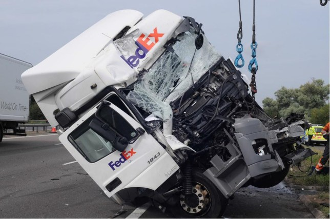 Undated handout photo issued by Thames Valley Police of the cab of a Fed Ex lorry driven by David Wagstaff, who is facing jail after eight people were killed when their minibus was crushed in a motorway pile-up in an early morning crash on the M1 on the August bank holiday weekend last year. Wagstaff, from Stoke, was released on continuing bail. He will be sentenced alongside Masierak at Aylesbury Crown Court on March 23. PRESS ASSOCIATION Photo. Issue date: Wednesday March 7, 2018. Four other passengers were left seriously injured when the vehicle was forced into and under a lorry which driver Ryszard Masierak had stopped in the slow lane of the motorway. Minibus driver Cyriac Joseph was waiting with his hazard lights on for the chance to go around Masierak's lorry when he was hit by another lorry, driven by David Wagstaff. See PA story COURTS M1. Photo credit should read: West Midlands Police/PA Wire NOTE TO EDITORS: This handout photo may only be used in for editorial reporting purposes for the contemporaneous illustration of events, things or the people in the image or facts mentioned in the caption. Reuse of the picture may require further permission from the copyright holder.