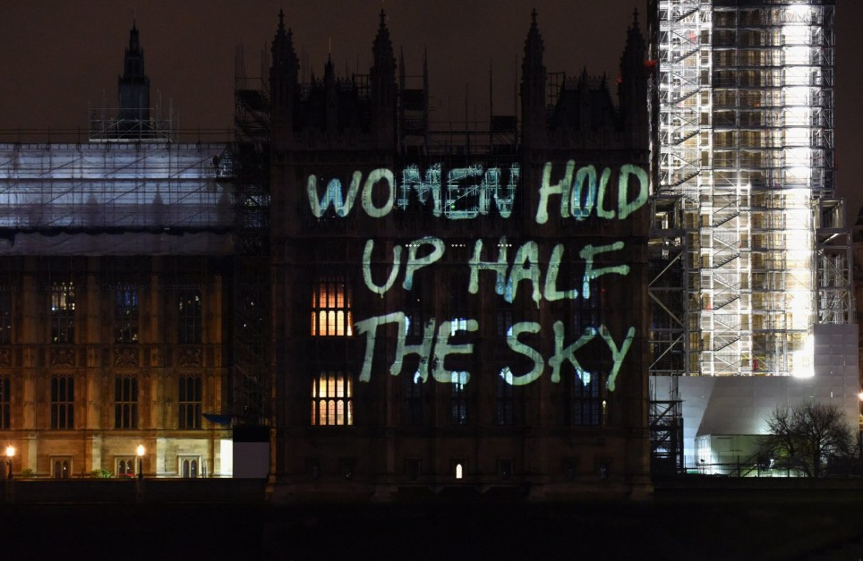 LONDON, ENGLAND - MARCH 07: Messages are projected onto the Houses of Parliament to mark the start of International Women's Day on March 7, 2018 in London, England. (Photo by Nicky J Sims/Getty Images for GladLife Ltd)