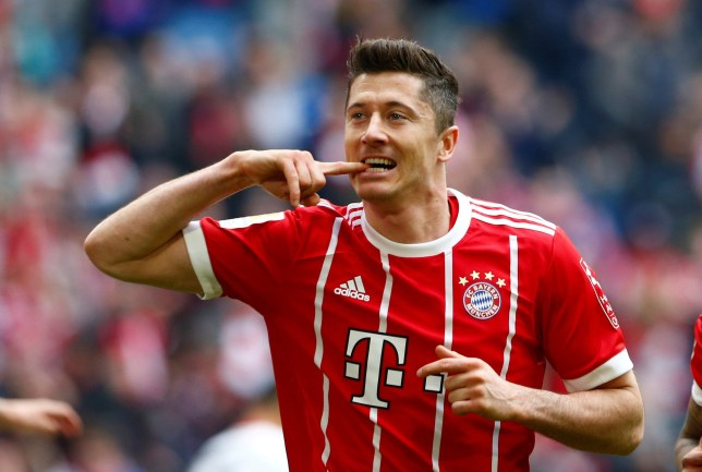 Soccer Football - Bundesliga - Bayern Munich vs Hamburger SV - Allianz Arena, Munich, Germany - March 10, 2018 Bayern Munich's Robert Lewandowski celebrates scoring their third goal REUTERS/Michaela Rehle DFL RULES TO LIMIT THE ONLINE USAGE DURING MATCH TIME TO 15 PICTURES PER GAME. IMAGE SEQUENCES TO SIMULATE VIDEO IS NOT ALLOWED AT ANY TIME. FOR FURTHER QUERIES PLEASE CONTACT DFL DIRECTLY AT + 49 69 650050 TPX IMAGES OF THE DAY