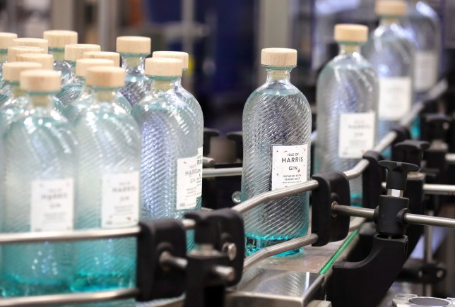File photo dated 18/10/16 of gin bottles on the production line at the Isle of Harris Distillery in Scotland's Western Isles. Gin sales hit a record high at Christmas after consumers bought the equivalent of a bottle for every adult in the UK last year, according to latest figures. PRESS ASSOCIATION Photo. Issue date: Sunday March 11, 2018. See PA story CONSUMER Gin. Photo credit should read: Andrew Milligan/PA Wire