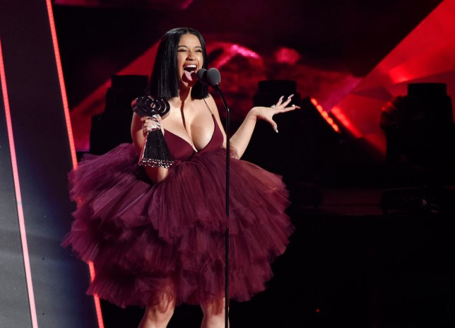 Singer Cardi B accepts the Best New Artist award during the 2018 iHeartRadio Music Awards at The Forum on Sunday, March 11, 2018, in Inglewood, Calif. (Photo by Chris Pizzello/Invision/AP)