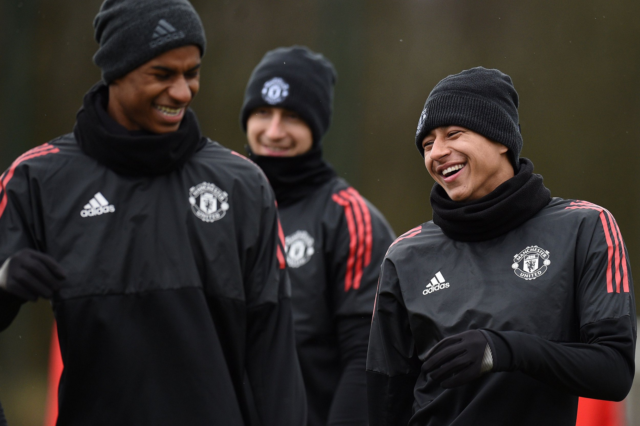 Manchester United's English striker Marcus Rashford (L) and Manchester United's English midfielder Jesse Lingard (R) attend a team training session at the club's training complex near Carrington, west of Manchester in north west England on March 12, 2018, on the eve of their UEFA Champions League round of 16 second-leg football match against Sevilla. / AFP PHOTO / Oli SCARFFOLI SCARFF/AFP/Getty Images