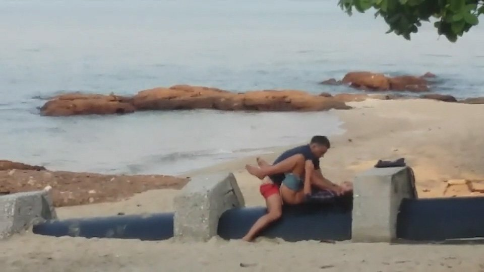 Having sex on a beach