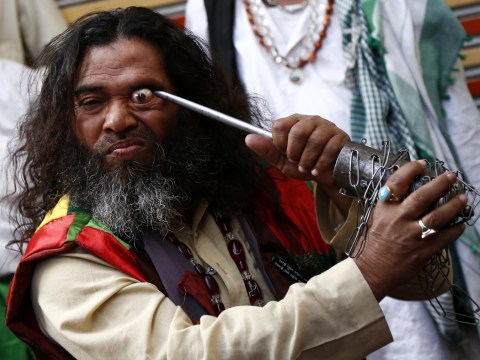 Men stick knives into their eyes to make them pop out at religious festival