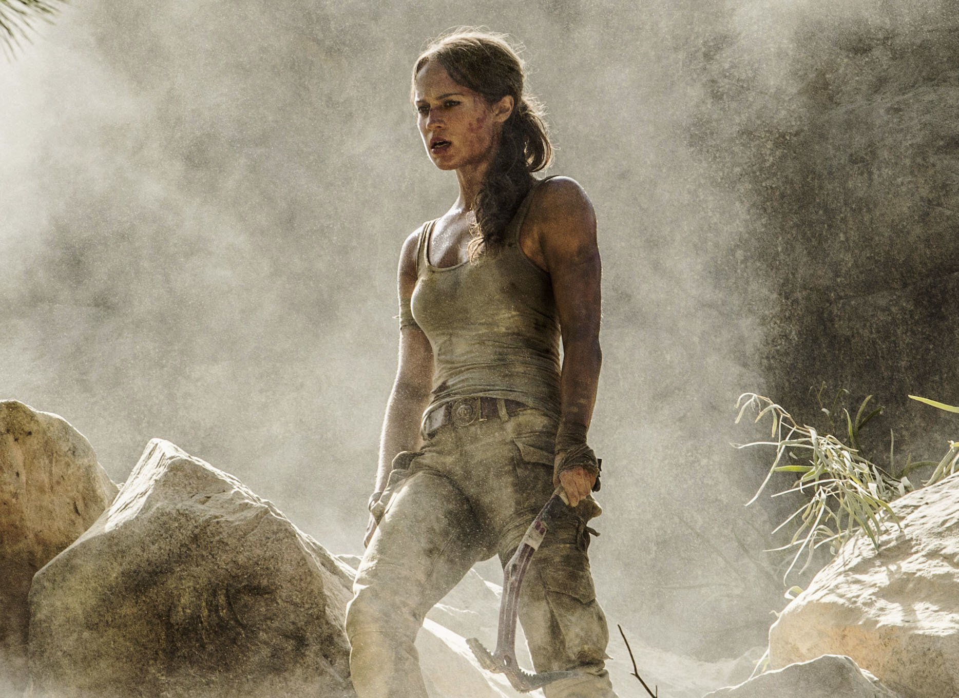 """This image released by Warner Bros. Pictures shows Alicia Vikander in a scene from """"Tomb Raider."""" It took weeks of training and plates full of protein to turn former ballerina Alicia Vikander into action star Lara Croft. (Ilze Kitshoff/Warner Bros. Pictures via AP)"""
