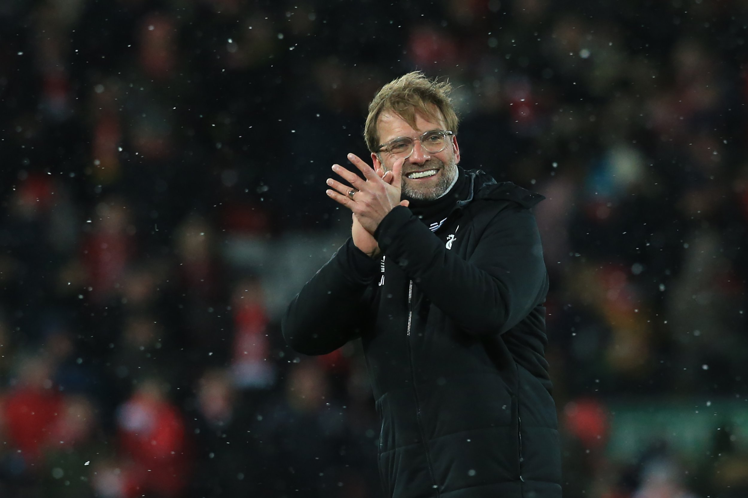 Liverpool's German manager Jurgen Klopp gestures after the English Premier League football match between Liverpool and Watford at Anfield in Liverpool, north west England on March 17, 2018. / AFP PHOTO / Lindsey PARNABY / RESTRICTED TO EDITORIAL USE. No use with unauthorized audio, video, data, fixture lists, club/league logos or 'live' services. Online in-match use limited to 75 images, no video emulation. No use in betting, games or single club/league/player publications. / LINDSEY PARNABY/AFP/Getty Images