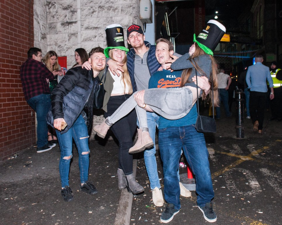 MERCURY PRESS. 17.03.18. Manchester, UK. Pictured: Revellers in Manchester battled snow, wind and rain tonight [SAT] to celebrate St. Patricks Day in style. Photo Credit: James Speakman / Mercury Press