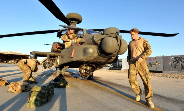 Previously unissued picture dated 01/11/2012 of Prince Harry or just plain Captain Wales as he is known in the British Army, does a pre-flight check of his Apache Helicopter after starting his 12 hour VHR (very high ready-ness) shift at the British controlled flight-line in Camp Bastion southern Afghanistan, where he is serving as an Apache Helicopter Pilot/Gunner with 662 Sqd Army Air Corps, from September 2012 for four months until January 2013.