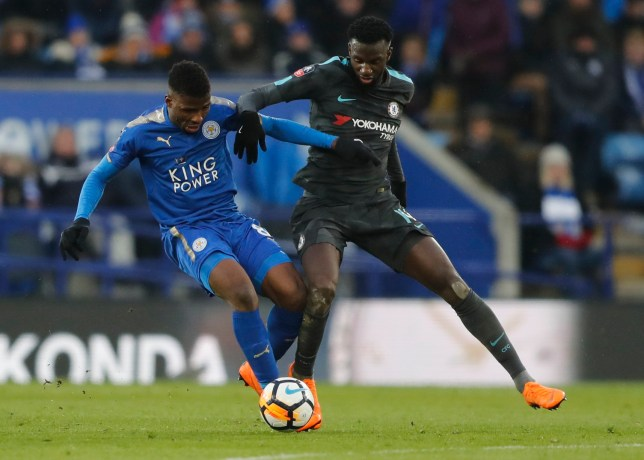 Leicester's Kelechi Iheanacho, left, is challenged by Chelsea's Tiemoue Bakayoko during the English FA Cup quarterfinal soccer match between Leicester City and Chelsea, at the King Power stadium in Leicester, England, Sunday, March 18, 2018. (AP Photo/Frank Augstein)