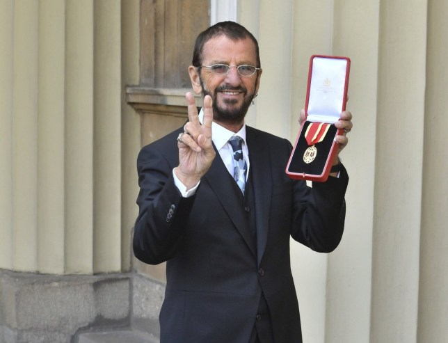 Musician Ringo Starr, poses for photographers after being awarded a knighthood, during an Investiture ceremony at Buckingham Palace, in London, Tuesday March 20, 2018. (John Stillwell/Pool Photo via AP)