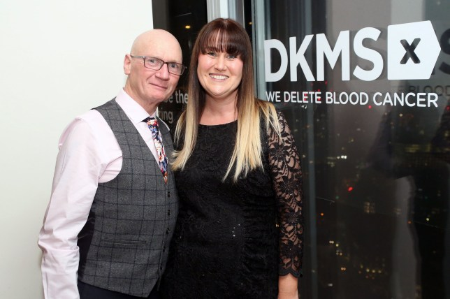 """Undated handout photo issued by DKMS of Peter Milburn and Aysha Lord at the charity's Let's Make a Spark Award ceremony, as the father of four who survived blood cancer has met and thanked the """"genetic twin"""" stem cell donor who saved his life. PRESS ASSOCIATION Photo. Issue date: Wednesday March 21, 2018. Strict regulations mean donors and patients rarely meet face-to-face but Mr Milburn, 56, finally met Mrs Lord, 40, through the charity DKMS on Tuesday. See PA story HEALTH Donor. Photo credit should read: Justin Grainge/DKMS/PA Wire NOTE TO EDITORS: This handout photo may only be used in for editorial reporting purposes for the contemporaneous illustration of events, things or the people in the image or facts mentioned in the caption. Reuse of the picture may require further permission from the copyright holder."""