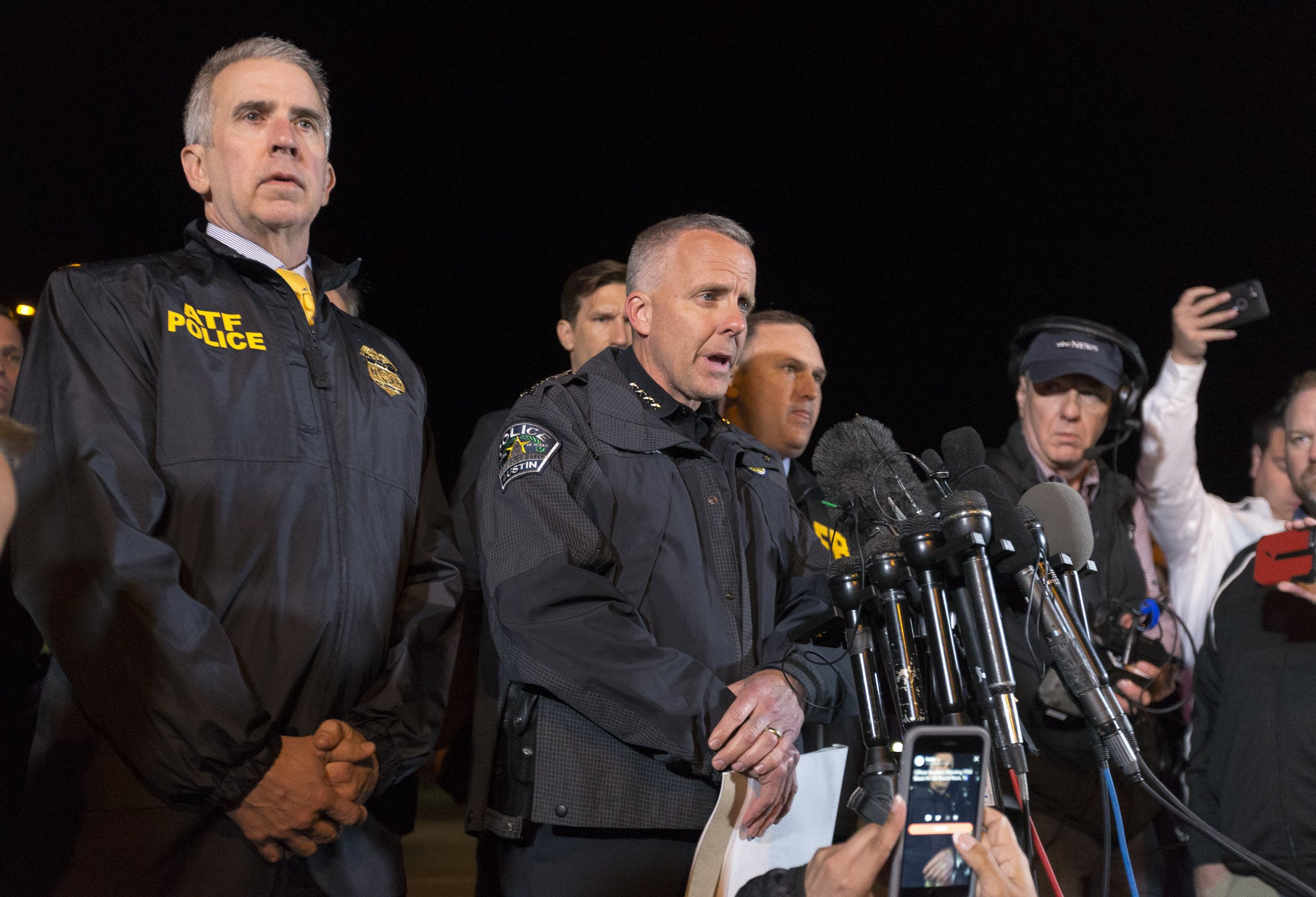 epa06617186 ATF Agent in Charge Fred Milanowski (L) and Interim Austin Police Chief Brian Manley (C) speak to the media as law enforcement investigates the scene where a bombing suspect allegedly blew himself up after being confronted by police in Round Rock, Texas, USA, 21 March 2018. The bombing suspect was identified by police and according to media reports he allegedly blew himself up after being confronted by police after being sought in connection with more than five bombings across the Austin, Texas area. EPA/STEPHEN SPILLMAN