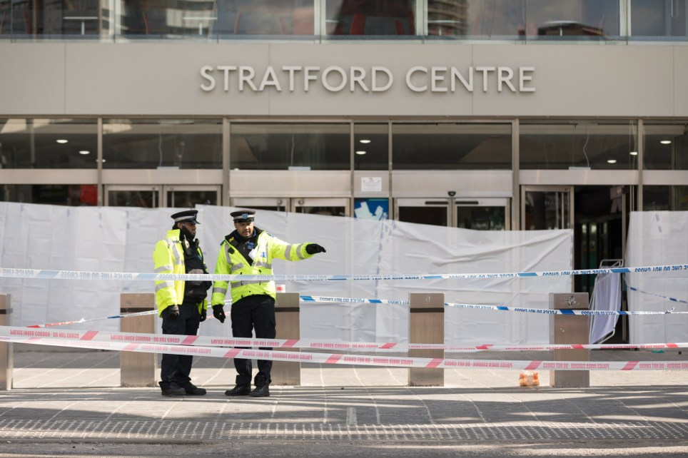 ? Licensed to London News Pictures. 21/03/2018. London, UK. The police cordon at the scene outside the shopping centre, the Stratford Centre in east London today, where a murder investigation has been launched after a man, believed to be in his early 20's was fatally stabbed last night. Photo credit: Vickie Flores/LNP