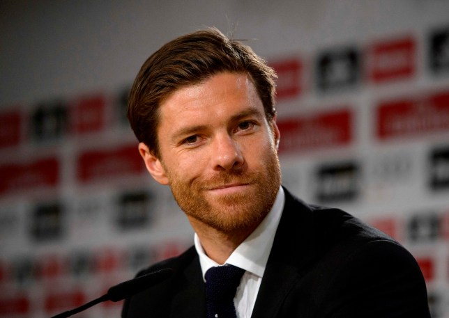 (FILES) In this file photo taken on August 29, 2014 Real Madrid's midfielder Xabi Alonso smiles during a press conference at the Santiago Bernabeu stadium in Madrid on August 29, 2014. Spanish prosecutors have called for Xabi Alonso to be sentenced to five years in prison after the former Real Madrid and Liverpool midfielder was accused of tax fraud. The Madrid prosecution office announced on March 21, 2018 it was seeking the sentence for an alleged fraud of two million euros between 2010 and 2012. It is claimed Alonso used a company based on the Portugese island of Madeira to avoid declaring income earned from the 36-year-old's image rights. / AFP PHOTO / DANI POZODANI POZO/AFP/Getty Images