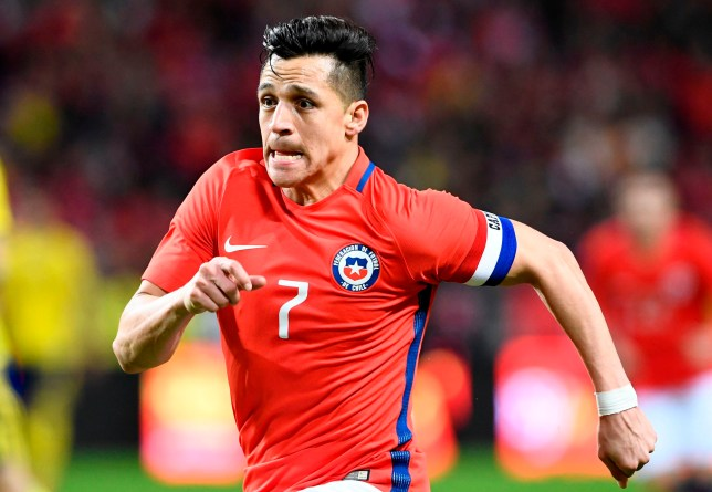 Chile's forward and team captain Alexis Sanchez reacts during the international friendly football match Sweden vs Chile at the Friends Arena in Solna, Sweden on March 24, 2018, in preparation of the 2018 Fifa World Cup. / AFP PHOTO / Jonathan NACKSTRANDJONATHAN NACKSTRAND/AFP/Getty Images