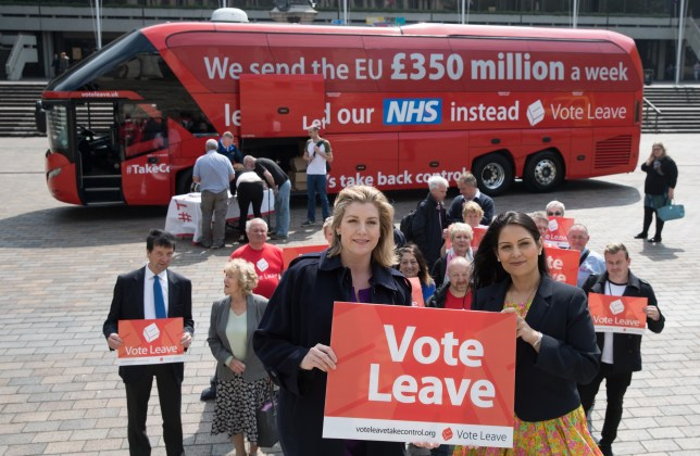 PORTSMOUTH, ENGLAND - MAY 13: Conservative MP and Minister of State for Employment, Priti Patel (R) and Penny Mordaunt, Minister of State for the Armed Forces and Conservative MP for Portsmouth North (L) hold up Vote Leave posters with supporters in front of the Vote Leave battle bus as it stops in Portsmouth on May 13, 2016 in Portsmouth, England. Portsmouth City Council members voted in March in favour of a motion declaring that the UK would be better off outside the EU declaring that Portsmouth should vote to leave the EU in the referendum to be held on Thursday June 23. (Photo by Matt Cardy/Getty Images)