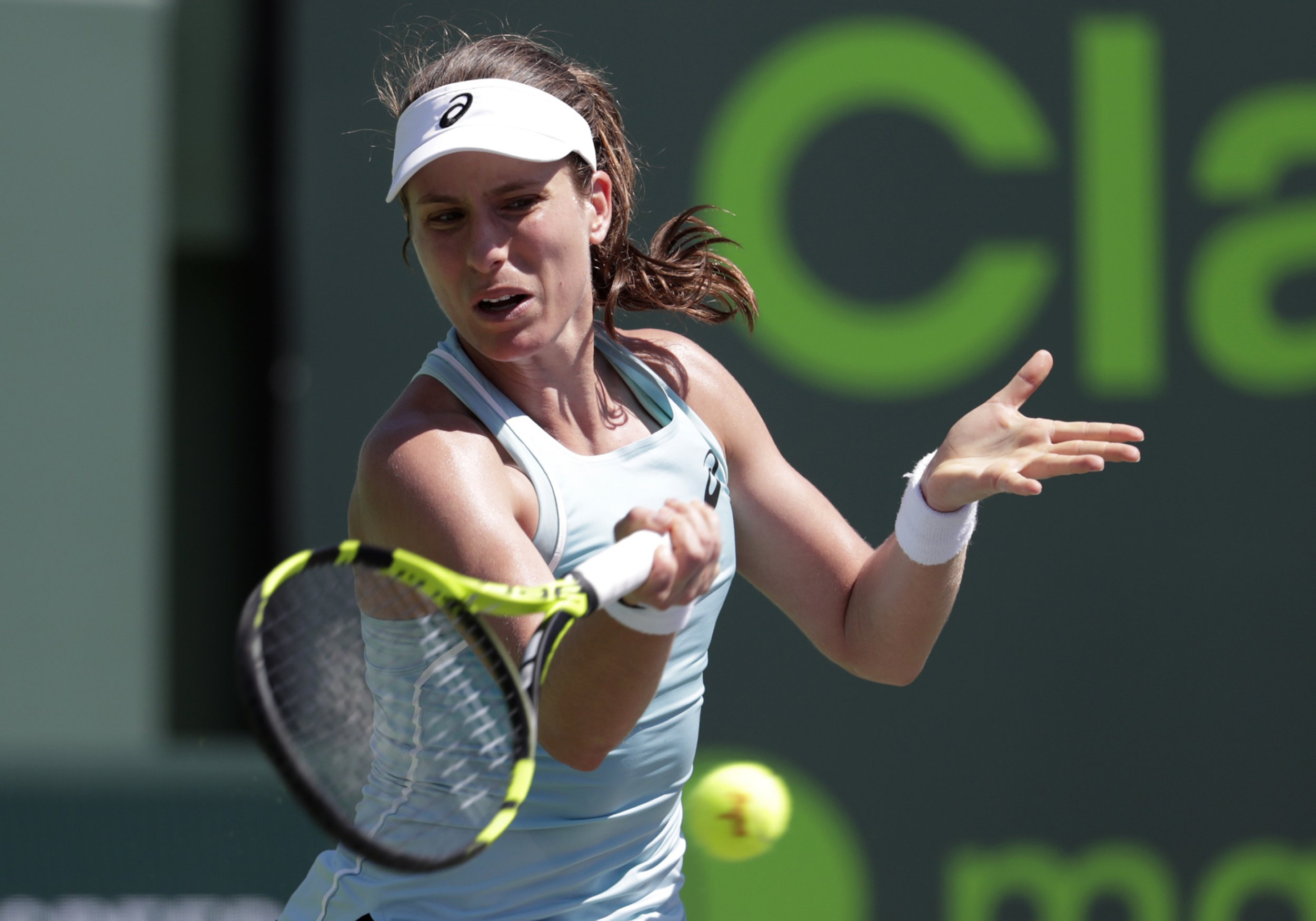 Johanna Konta, of Great Britain, returns to Elise Mertens, of Belgium, during the Miami Open tennis tournament, Sunday, March 25, 2018, in Key Biscayne, Fla. (AP Photo/Lynne Sladky)