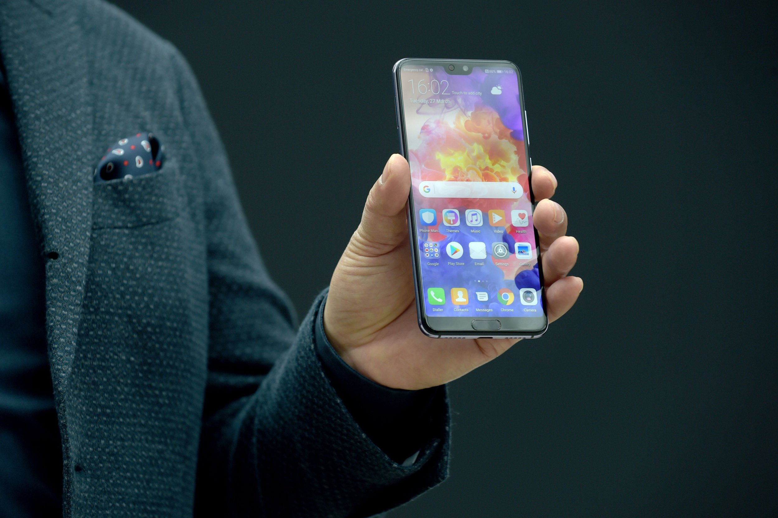 Telecom equipment company Huawei CEO Richard Yu presents the new P20 smartphone in Paris on March 27, 2018. / AFP PHOTO / ERIC PIERMONTERIC PIERMONT/AFP/Getty Images